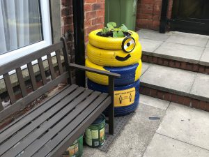 A one-eyed 'Binion' character made of recycled tyres in the garden at the Cambridge Street Hostel.