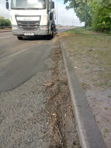 A road sweeper cleaning a slipway on the A180.