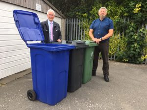 Pictured are Cllr Stewart Swinburn and Chris Dunn, deputy head of operations, with the two new bins and one of the existing green bins.